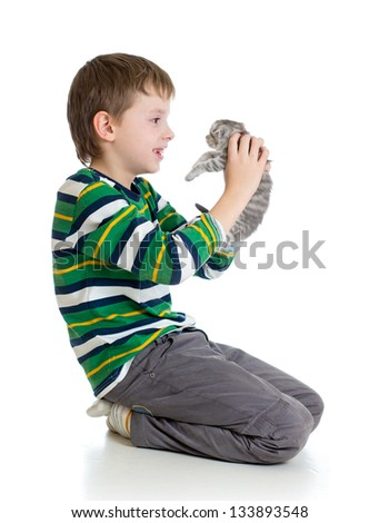child boy with kitten isolated on white background - stock photo