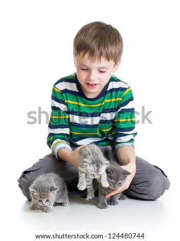 child boy with kittens isolated on white background