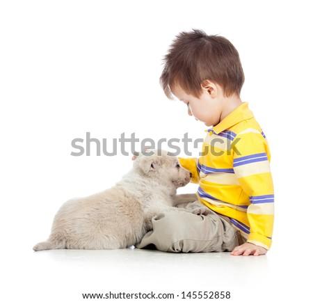 child boy with puppy dog - stock photo