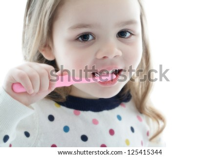 Child brushing teeth - stock photo