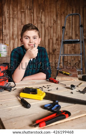 child builder for construction  work concept, funny boy - stock photo