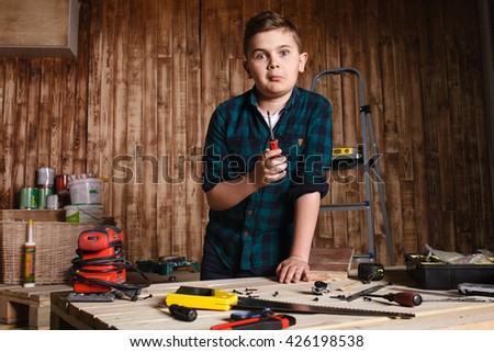 child builder for construction  work concept, funny boy ,emotions of surprise - stock photo