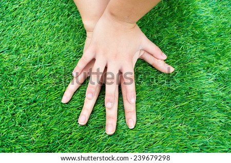 child by comparing the size of your hand with his mother - stock photo