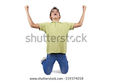 child celebrating with arms raised - stock photo