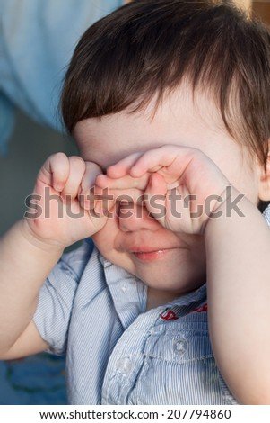 Child closed his eyes with his hands and crying - stock photo