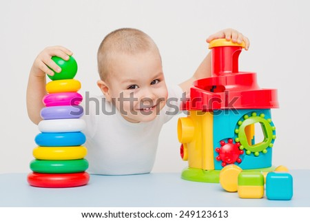 Child collects a pyramid