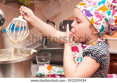 child cooking at home sweet pie, mixes ingredients - stock photo