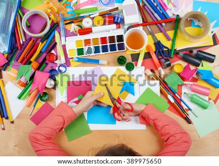 Child cut applique top view. Artwork workplace with creative accessories. Flat lay art tools for painting. - stock photo
