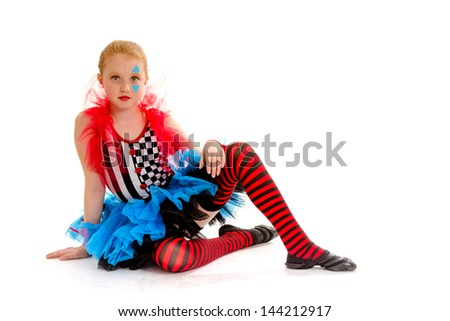 Child Dancer Poses in Costume as a Painted Circus Jester
