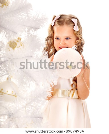 Child decorate white Christmas tree. Isolated.