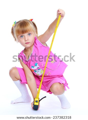 Child development, skills training concept.Little girl with construction tools.Isolated on white background. - stock photo