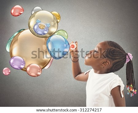 Child does with soap a teddy bear