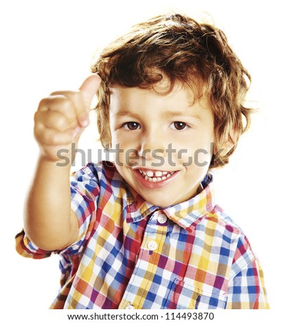 child doing a positive signal with his hand - stock photo