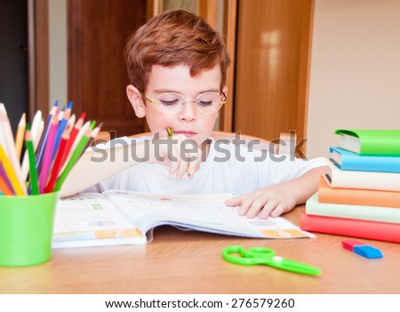 Child doing his homework - stock photo