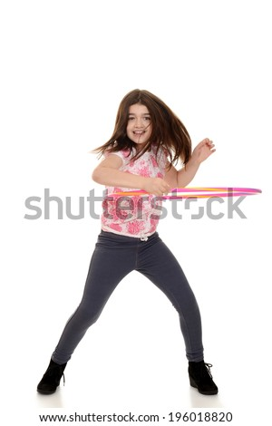 child doing hula hoop with motion blur - stock photo