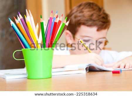 Child drawing with color pencils - stock photo