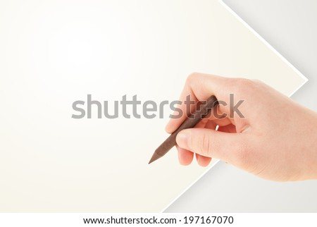 Child drawing with colorful crayon on empty plain blank paper  - stock photo