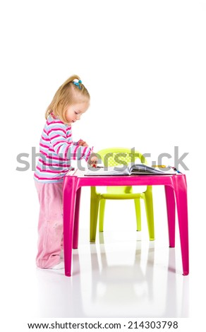 Child drawing with crayons isolated on white - stock photo