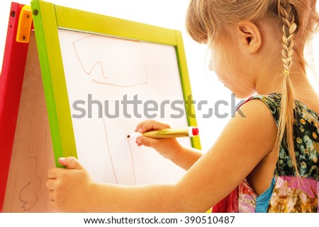 child draws on a white background on the board