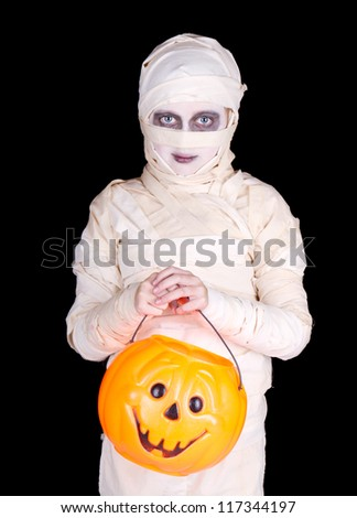 Child dressed as a mummy Halloween costume holding a trick or treat bucket