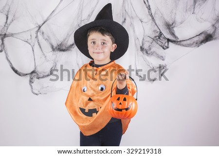 child dressed as a pumpkin for Halloween