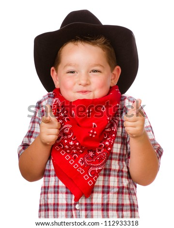 Child dressed up as cowboy playing isolated on white - stock photo