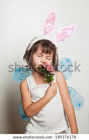 Child dresses up in costumes - stock photo