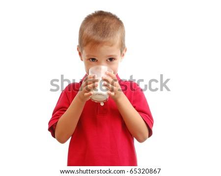 Child drinks milk isolated on white background - stock photo