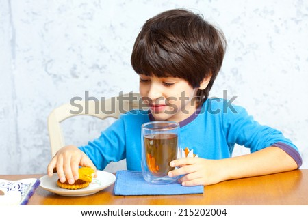 child drinks morning beverage, portrait - stock photo