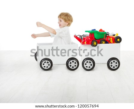 Child driving box car and wagon with toys. Delivery and shipping concept - stock photo