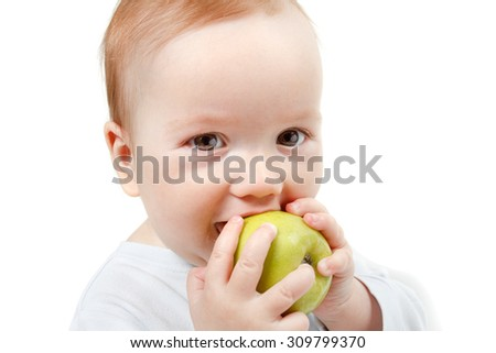 Child eating green apple. Studio Half Length Portrait , isolated on a white background