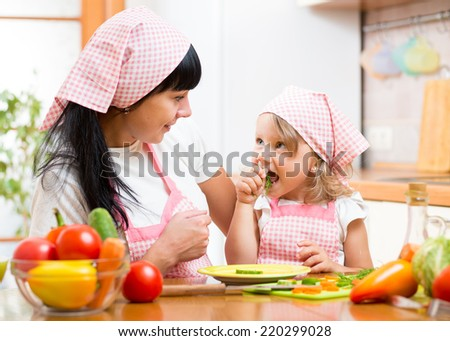 child eating healthy food on kitchen - stock photo