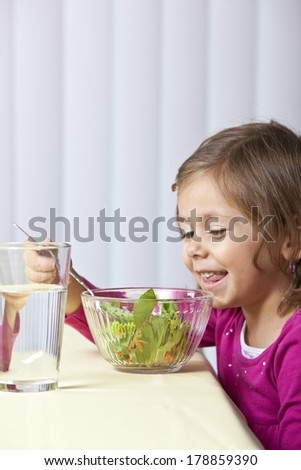 Child Eating Salad - stock photo