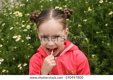 child eats candy  - stock photo