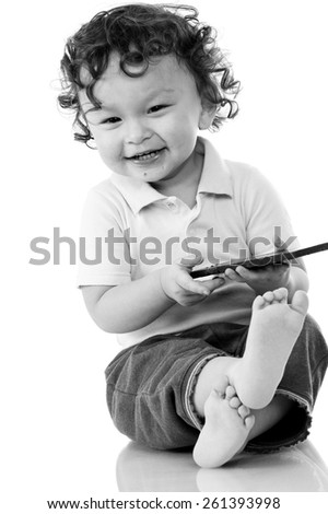 Child eats chocolate, isolated on a white background. - stock photo
