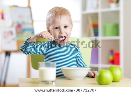 child eats healthy food at home or kindergarten