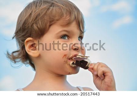 Child eats ice-cream - stock photo