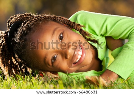 Child enjoying nice sunny day in a park.