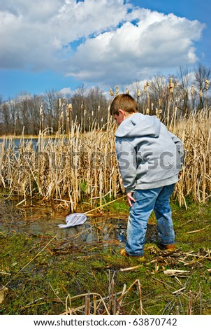 Child Exploring in Swamp - stock photo