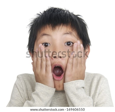 Child expressing surprise with his hands in his face - stock photo