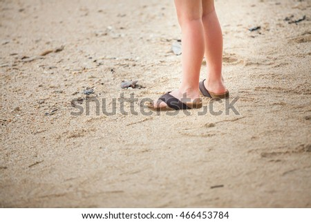 child feet in the sand at Khao Lak,Thailand.(Selective Focus)