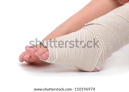 child foot wrapped with bandage - stock photo