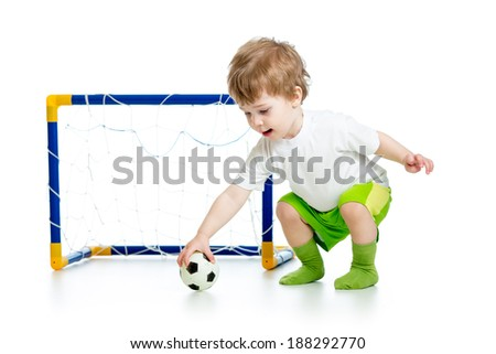 child football player holding soccer ball - stock photo