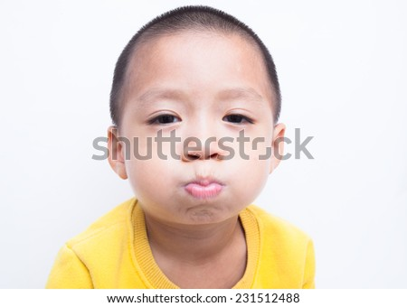 Child. funny little boy. White background