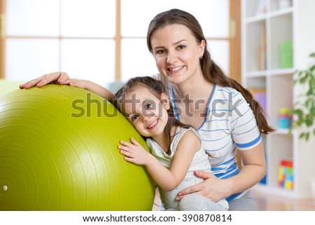 Child girl  and mother with fitness ball - stock photo