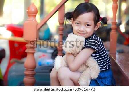 Child girl and Teddy Bear at home.