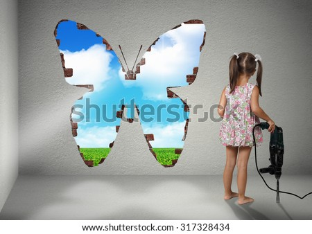Child girl break wall shape of a butterfly, renovation creative concept - stock photo