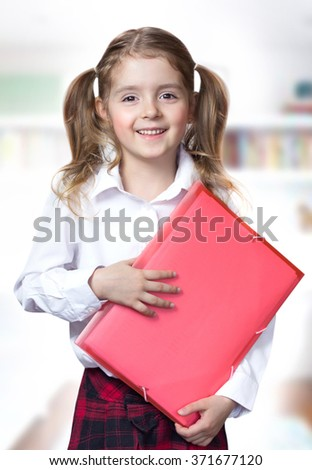 Child girl caucasian hold note folder.Pupil primary elementary school education concept. - stock photo