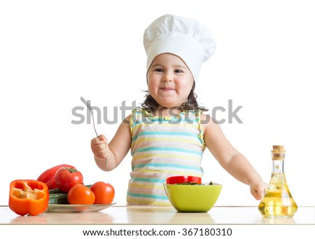 child girl chef cook with fresh vegetables, healthy eating concept