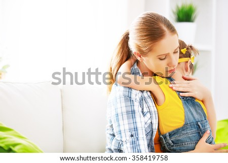 child girl daughter in an embrace his mother - stock photo